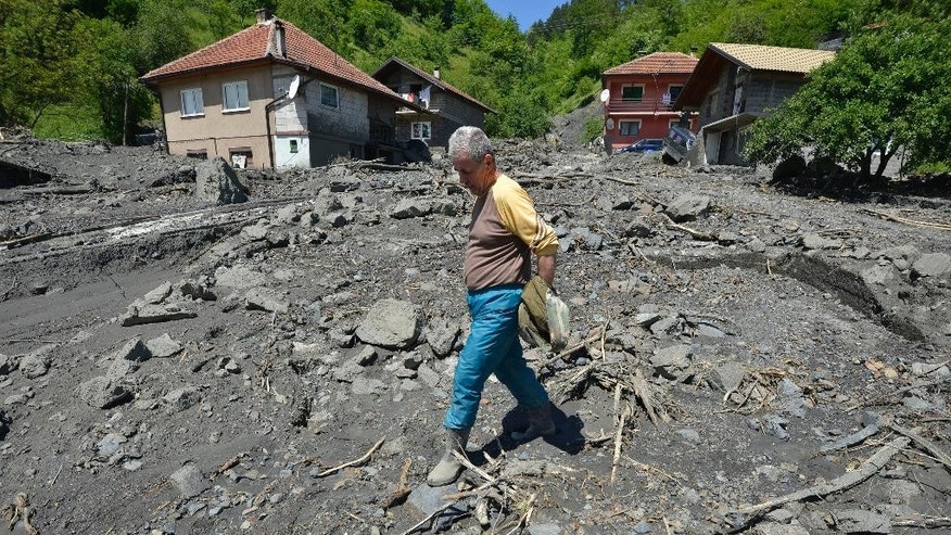 Ramiz Skopljak, 65, walks where his house once stood and was swept by the river last week in the village of Topcic Polje, near the Bosnian town of Zenica, 90 kilometers north of Sarajevo, on Monday May 19, 2014. At least 35 people have died in Serbia and Bosnia in the five days of flooding caused by unprecedented torrential rain, laying waste to entire towns and villages and sending tens of thousands of people out of their homes, authorities said. (AP Photo/Sulejman Omerbasic)