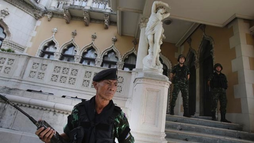 May 20, 2014: Thai soldiers stand guard outside Government House in Bangkok. (AP Photo/Sakchai Lalit)