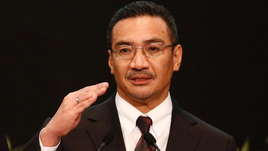 March 25, 2014: Malaysia's acting Transport Minister and Defense Minister Hishammuddin Hussein answers a reporter's questions during a press conference on the missing Malaysia Airlines, Flight 370, at Putra World Trade Centre (PWTC) in Kuala Lumpur, Malaysia. (AP Photo/Vincent Thian, File)