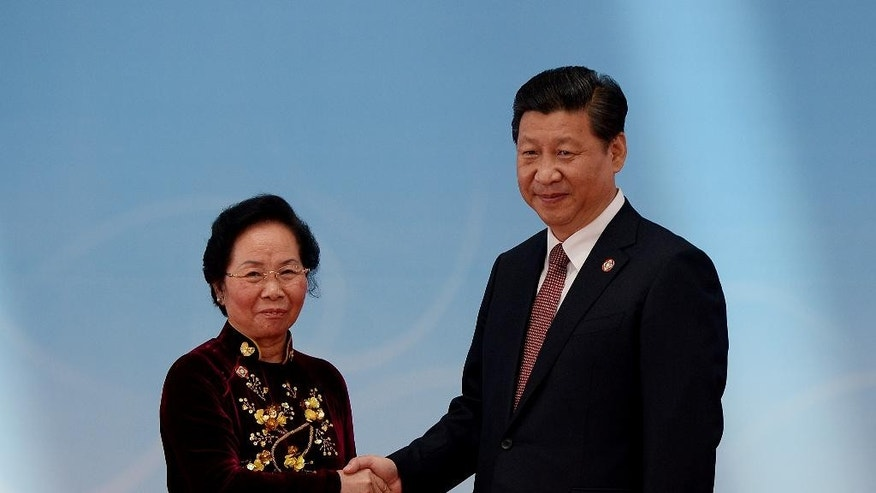 Vietnam's Vice President Nguyen Thi Doan, left, is greeted by Chinese President Xi Jinping before the opening ceremony at the fourth Conference on Interaction and Confidence Building Measures in Asia (CICA) summit in Shanghai, China Wednesday, May 21, 2014.  (AP Photo/Mark Ralston, Pool)