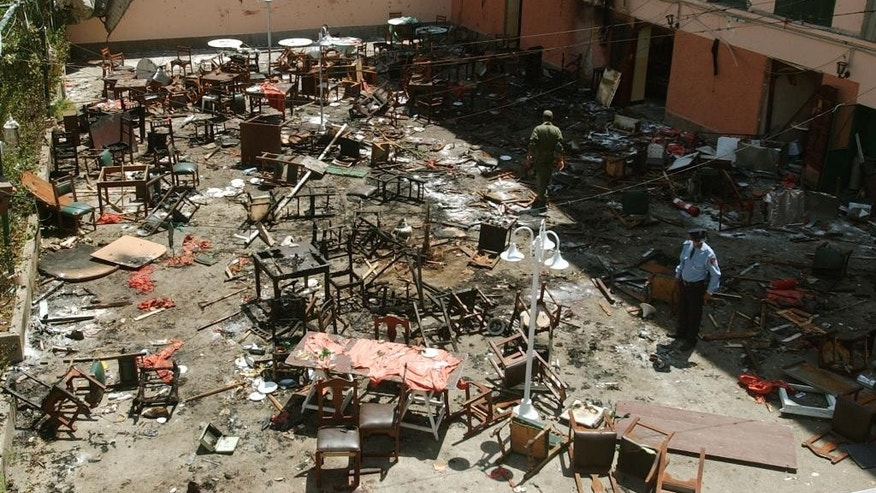 "FILE - This May 17, 2003 file photo shows the wreckage of the terrace of the Casa de Espana restaurant in Casablanca, Morocco, after a series of blasts in the Moroccan capital. The film, ""Horses of God,"" tells the story of 12 young men from the Sidi Moumen slum blew themselves up in a series of blasts in Morocco. (AP Photo/Denis Doyle, File)"