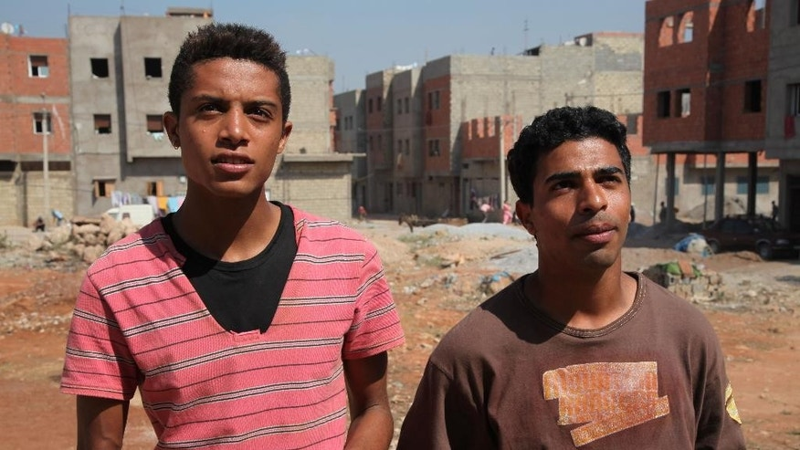 "This image released by Kino Lorber, Inc. shows Abdelilah Rachid, left, and Abdelhakim Rachid in a scene from ""Horses of God."" The film, directed by Nabil Ayouch, follows the path of four Moroccan men from the Sidi Moumen slum as they become suicide bombers. (AP Photo/Kino Lorber, Inc.)"