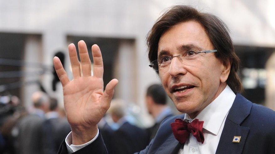FILE In this March 20, 2014 file photo, Belgian Prime Minister Elio Di Rupo waves as he arrives for an EU summit in Brussels. Walk through Belgium and feel that giddy sense of unity, the national football team is going to the World Cup again. Follow the election campaign though, and the division between Dutch- and French-speakers seems even worse than four years ago when it took a record 541 days to form a government uniting the bickering sides. (AP Photo/Eric Vidal, file)
