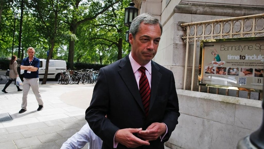 Nigel Farage, leader of Britain's United Kingdom Independence Party (UKIP) leaves after conducting a series of interviews in central London, Wednesday, May 21, 2014. Farage's party could be on track to win the biggest share of British votes in elections this week for the European Parliament _ a parliament Farage wants to abolish, along with the entire 28-nation EU bloc. (AP Photo/Lefteris Pitarakis)