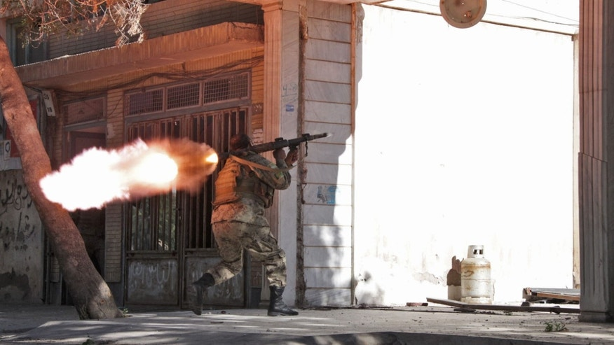 May 23, 2014 - An Afghanistan National Army (ANA) soldier fires his weapon at the site of a clash between insurgents and security forces over Indian Consulate in Herat, Afghanistan. Gunmen armed with machine guns and rocket-propelled grenades attacked the Indian Consulate but no one on the diplomatic staff was injured, police said.