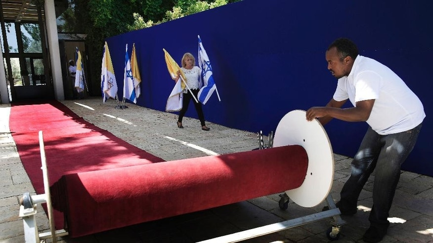 Workers at the Israeli president's residence make preparations ahead of the Papal visit to Jerusalem, Thursday, May 22, 2014. Pope Francis will visit the region for three days starting Saturday. (AP Photo/Tsafrir Abayov)