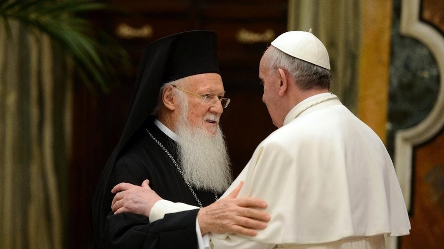 "FILE- In this March 20, 2013, file photo provided by the Vatican paper L' Osservatore Romano, Pope Francis, right, meets Bartholomew I, the first ecumenical patriarch to attend the installation of a Pope since the Catholic and Orthodox church split nearly 1,000 years ago, at the Vatican. Pope Francis insists his weekend pilgrimage to the Middle East is a ""strictly religious"" commemoration of a key turning point in Catholic-Orthodox relations. But the three-day visit is the most delicate mission of his papacy and will test his diplomatic chops as he negotiates Israeli-Palestinian tensions and fallout from Syria's civil war. (AP Photo/Osservatore Romano, File)"