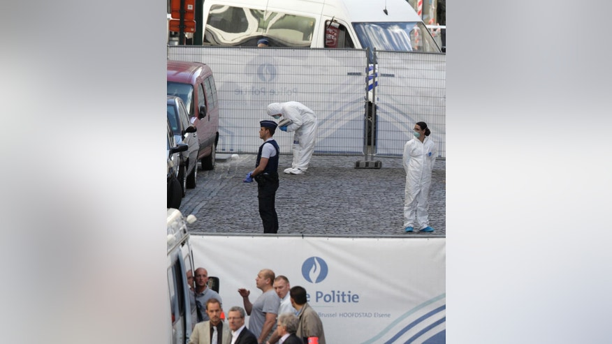 "Forensic experts examine the site of a shooting at the Jewish museum in Brussels, Saturday, May 24, 2014. Belgian officials say that at least three people have been killed in gunfire at the Jewish Museum in Brussels. Belgian Foreign Minister Didier Reynders, in a post on Twitter, said he was ""shocked by the murders committed at the Jewish Museum"" on Saturday afternoon. He said he had seen the bodies of the victims. At least three persons were killed in the incident, and a Brussels fire department spokesman said one person was wounded. (AP Photo/Yves Logghe)"