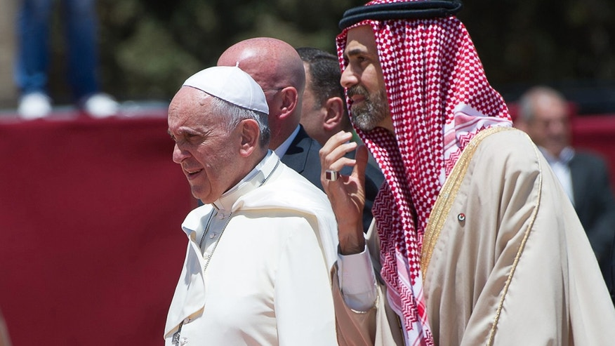 In this photo provided by the Vatican newspaper L'Osservatore Romano, Pope Francis is welcomed upon his arrival in Amman, Jordan, Saturday, May 24, 2014. (AP Photo/L'Osservatore Romano, ho)
