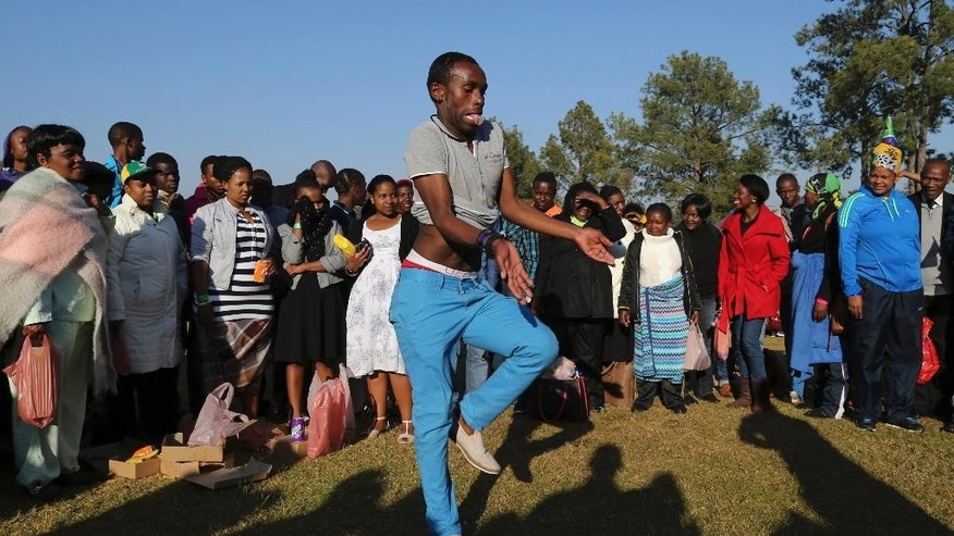 A man dances at the south lawns of the government's Union Building, ahead of the inauguration ceremony of South African President Jacob Zuma, in Pretoria, South Africa, Saturday, May 24, 2014. Zuma will be sworn in later to serve the second term after the country's fifth democratic elections. (AP Photo/Themba Hadebe)
