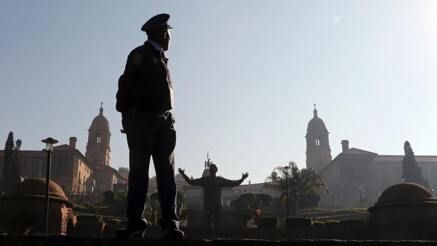 A police officer stands at the south lawns of the government's Union Building, ahead of the inauguration ceremony of South African President Jacob Zuma, in Pretoria, South Africa, Saturday, May 24, 2014. Zuma will be sworn in later to serve the second term after the country's fifth democratic elections. (AP Photo/Themba Hadebe)