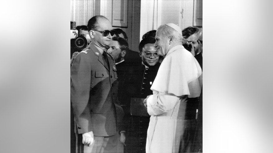 FILE- In this Friday, June 17, 1983 file photo  Pope John Paul II meets with Polish premier Wojciech Jaruzelski at Belvedere Palace in Warsaw.   A military hospital spokesman in Warsaw  Sunday May 25, 2014 said  Poland's last communist leader, Gen. Wojciech Jaruzelski, has died at age 90. Spokesman Grzegorz Kade said Jaruzelski died in the hospital, where he suffered a stroke earlier this month. He was previously treated for cancer. (AP Photo/Massimo Sambucetti, File)