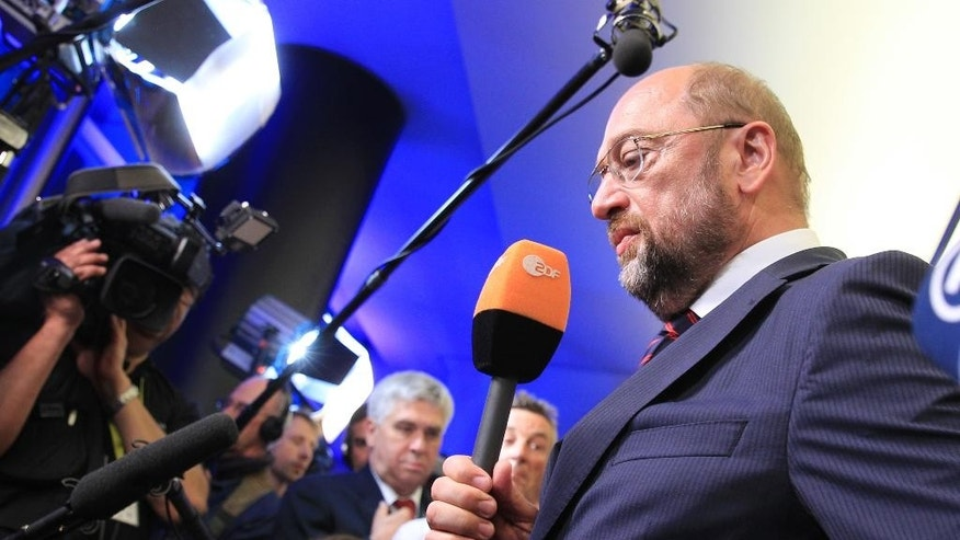 European Parliament President Martin Schulz and candidate for the Socialist party to become European Commission President, looks down during an interview, at the European Parliament in Brussels, Sunday, May 25, 2014. Exit polls showed the far right and Eurosceptics making sweeping gains in European Parliament elections Sunday, signaling a major political shift toward parties that want to slash the European Union's powers or abolish it altogether. (AP Photo/Yves Logghe)