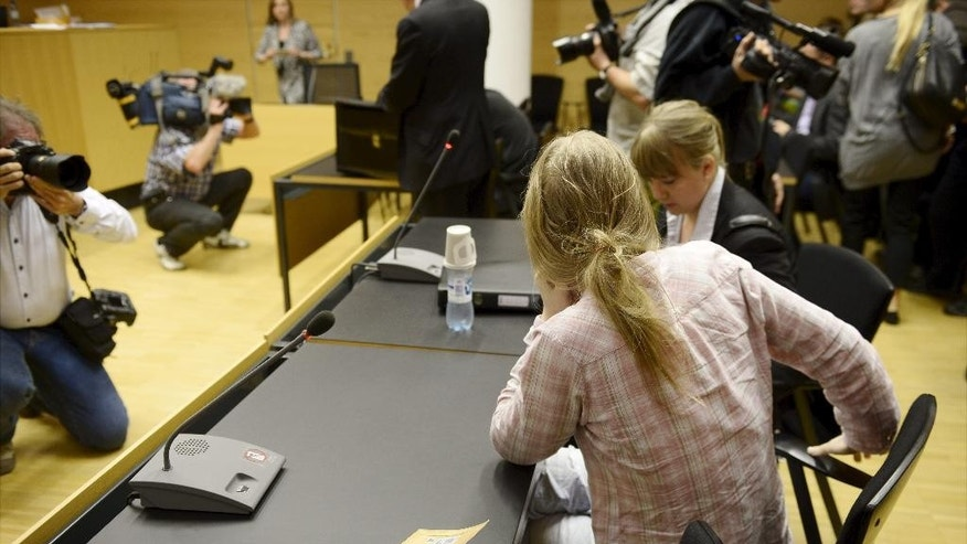 An unidentified woman, sits with her back to camera, at a court hearing, in Helsinki, Finland, Monday, May 26, 2014. A man and a woman are being tried for planning an attack at the University of Helsinki with the aim of killing several people and for possessing weapons to carry out the slaughter. The case opened Monday at Helsinki District Court against the suspects, who were not named. They were not students at the university. (AP Photo/Lehtikuva, Antti Aimo-Koivisto)  FINLAND OUT