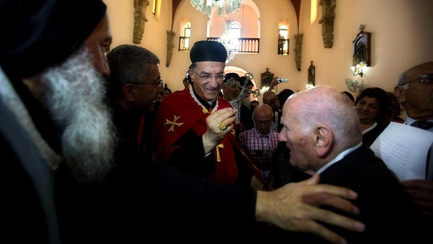 Cardinal Bechara Rai, head of the Maronite Catholic Church, center, visits  a church in Jaffa, a mixed Jewish and Arab neighborhood in Tel Aviv, Israel, Monday, May 26, 2014. The leader of Lebanon's largest Christian denomination visited Jerusalem on Sunday, an official said, making him the first Lebanese religious leader to set foot in the city since Israel captured its traditionally Arab eastern sector in the 1967 Mideast war. (AP Photo/Sebastian Scheiner)