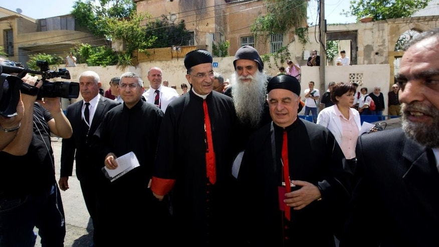 Cardinal Bechara Rai, head of the Maronite Catholic Church, center, arrives to visit a church in Jaffa, a mixed Jewish and Arab neighborhood in Tel Aviv, Israel, Monday, May 26, 2014. The leader of Lebanon's largest Christian denomination visited Jerusalem on Sunday, an official said, making him the first Lebanese religious leader to set foot in the city since Israel captured its traditionally Arab eastern sector in the 1967 Mideast war. (AP Photo/Sebastian Scheiner)