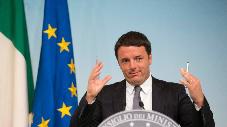 Italian Premier Matteo Renzi answers reporters' questions during a press conference in Rome, Monday, May 26, 2014. In Italy the main government party, the Democrats led by Premier Matteo Renzi, had beaten off a challenge by the anti-euro 5-Star Movement of comic Beppe Grillo. The center-left Democrats won 40,8 percent, while Grillo's anti-establishment movement garnered 21,1 percent. (AP Photo/Alessandra Tarantino)