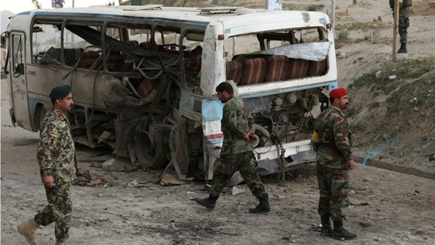 May 26, 2014: Afghan National army soldiers arrive to the scene after suicide attack in Kabul, Afghanistan. (AP)