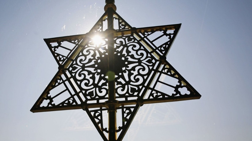 "DRESDEN, GERMANY - SEPTEMBER 14: The Star of David is seen over the entrance of the New Synagoge at the ordination of new rabbis on September 14, 2006 in Dresden, Germany. Abraham Geiger College, the first liberal rabbinical seminary founded in Continental Europe since World War II, ordains the first three candidates as rabbis since the ""Hochschule fuer die Wissenschaft des Judentums"" in Berlin was forcefully closed in 1942. The three newly ordained rabbis will become members of the Central Conference of American Rabbis and will serve communities in Munich, Oldenburg and Cape Town. (Photo by Carsten Koall/Getty Images)"