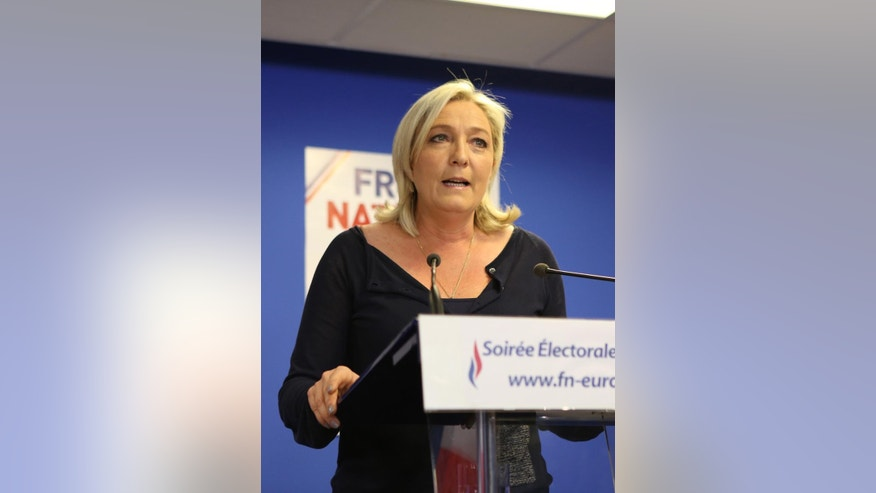 Far right party National Front leader Marine Le Pen addresses reporters at the party's headquarters in Nanterre, west of Paris, Sunday May 25, 2014, following the victory of her party in the European Elections.(AP Photo/Remy de la Mauviniere)