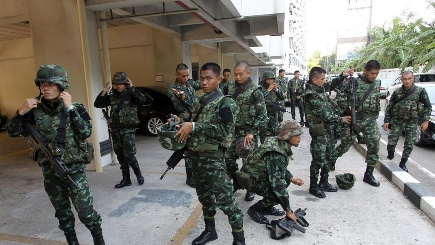 Thai soldiers guard at the office of the Attorney General as anti-government protest leader Suthep Thaugsuban and others were taken to hear insurrection charge in Bangkok, Thailand Monday, May 26, 2014. Thailand's ruling military council stiffened its warnings Sunday against protests over its takeover of power, with its patience apparently wearing thin over demonstrations that have been growing in size and boldness. (AP Photo/Apichart Weerawong)