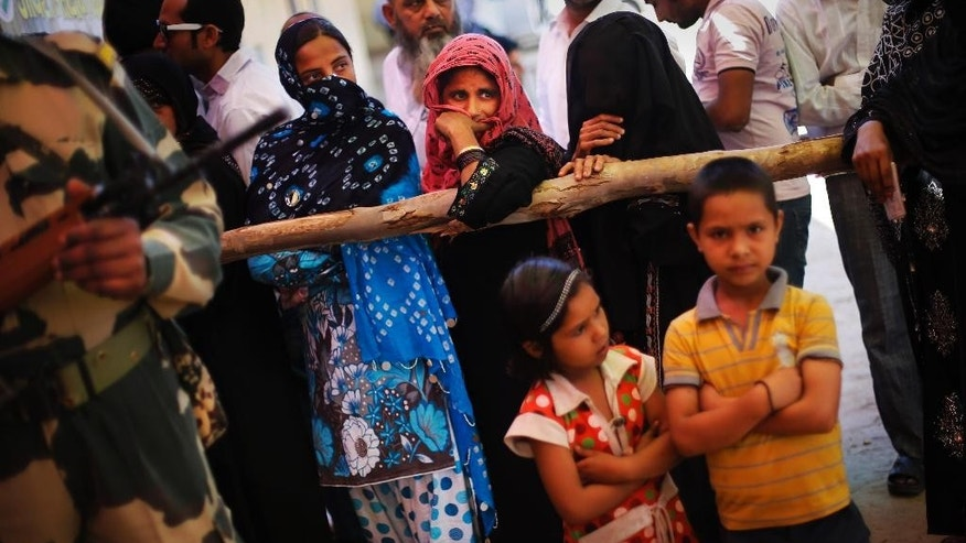 In this April 10, 2014 photo, Indian Muslims wait in a queue to cast their votes in Muzaffarnagar, India, an area that witnessed one of the worst Hindu Muslim riots of recent times in which 69 people were killed and over 40,000 were rendered homeless. Muslims account for more than 13 percent of India's population and face no legal discrimination under the country's secular constitution. But while many Indian Muslims have held high government offices  - the current vice president Hamid Ansari is Muslim - the community is largely poor and fares badly on most socio-economic indicators like health and education. (AP Photo/Altaf Qadri)