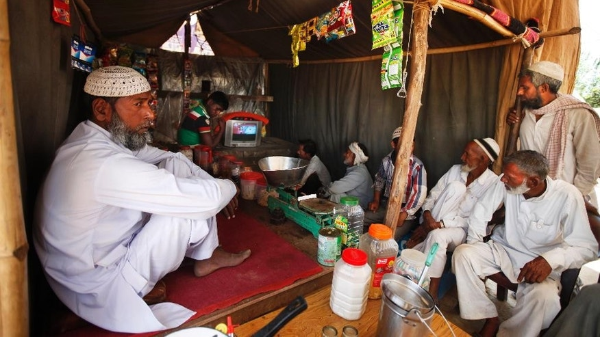 In this April 10, 2014 photo, displaced Indian Muslims watch election news on television at a relief camp in Muzaffarnagar, India, an area that witnessed one of the worst Hindu Muslim riots of recent times in which 69 people were killed and over 40,000 were rendered homeless. Muslims account for more than 13 percent of India's population and face no legal discrimination under the country's secular constitution. But while many Indian Muslims have held high government offices - the current vice president Hamid Ansari is Muslim - the community is largely poor and fares badly on most socio-economic indicators like health and education. (AP Photo/Altaf Qadri)