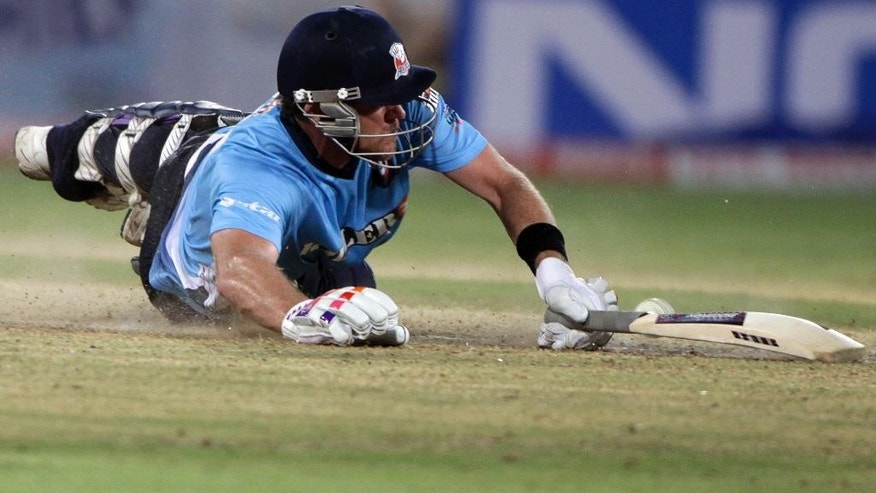 FILE - In this Sept. 20, 2011 file photo, Auckland's Lou Vincent survives a run during a Champions League Twenty20 cricket qualifying match against Somerset in Hyderabad, India. In May 2014, former New Zealand team player Vincent was charged with 14 offences under the England Cricket Board's anti-corruption code for alleged fixing in two English county matches. Recent scandals in business, politics and sports, may put that reputation under threat. Some observers say the South Pacific nation's sterling record for fairness may have made it complacent and less watchful for shady behavior. (AP Photo/Mahesh Kumar A., File)