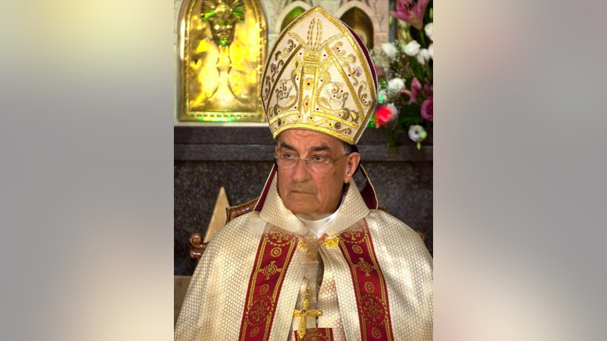 "Cardinal Bechara Rai, the first leader of Lebanon's largest Christian sect, the Maronite Catholic Church to visit Jerusalem since Israel captured the city's eastern sector, attends mass in the West Bank town of Beit Sahour, near Bethlehem, Tuesday, May 27, 2014. Rai's visit has triggered anger in Lebanon, which bans its citizens from traveling to archenemy Israel. The militant Islamist Shiite group Hezbollah warned that Rai's trip to Jerusalem could have ""dangerous and negative repercussions."" (AP Photo/Majdi Mohammed)"