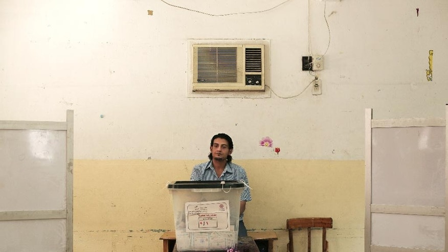 An election worker waits for voters in front of a ballot box at a polling station in Cairo, Egypt, Wednesday, May 28, 2014. Egyptian authorities scrambled to rescue the country's presidential election from the embarrassment of a low voter turnout, but few people trickled to the polls on Wednesday even after the balloting was extended for a third day. A low turnout will likely rob the all-but-certain winner, former army chief Abdel-Fattah el-Sissi, of the overwhelming show of public support he sought in the vote. (AP Photo/Nariman El-Mofty)