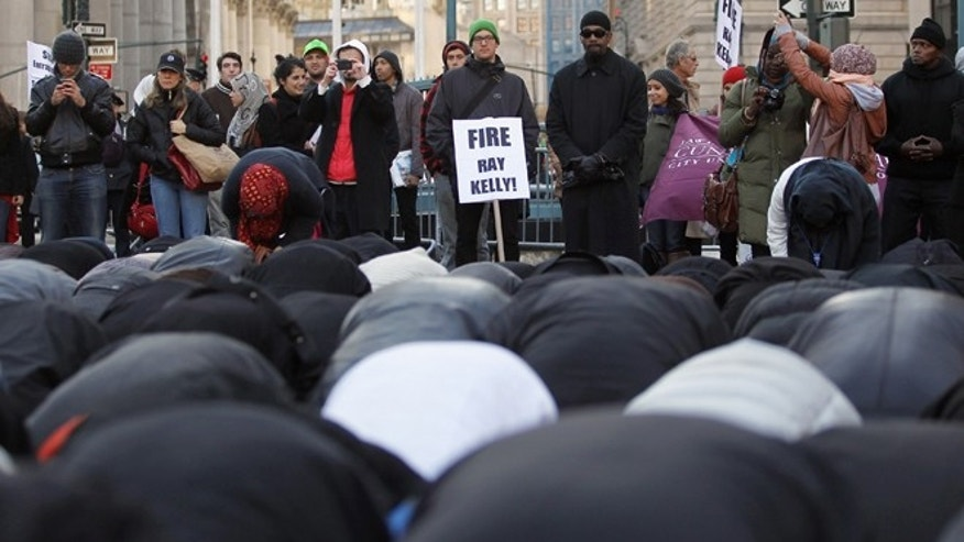 Muslims pray in Foley Square during a protest of ethnic profiling on November 18, 2011 in New York City.