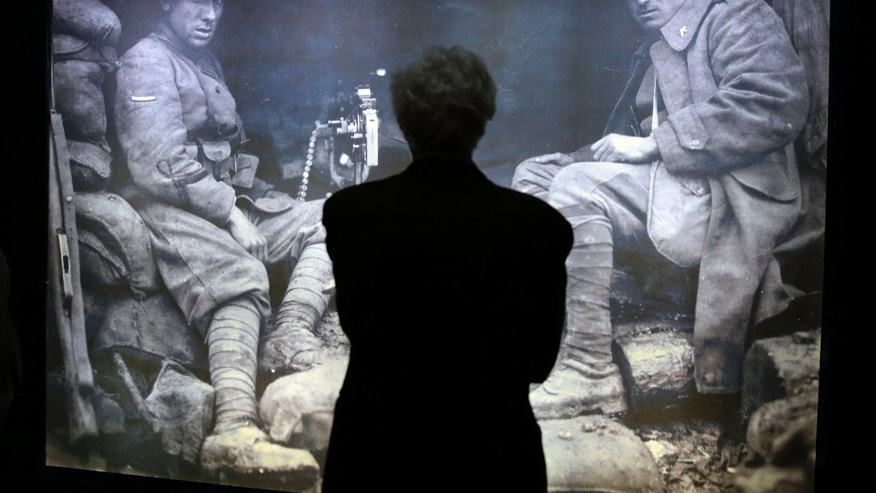 May 30, 2014 - A man stands in front a WWI picture in the museum at Italy's Tomb of the Unknown Soldier in Rome. The exhibit contains censored images of executions and prisoners of war, as well as notifications for military tribunal death sentences that were posted on the streets of Rome.