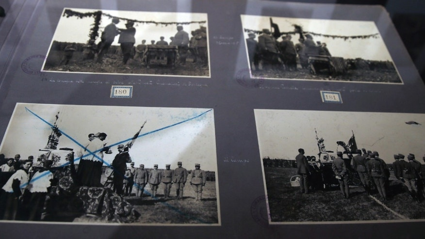 May 30, 2014 - Censored images of executions and prisoners of war are displayed in the museum at Italy's Tomb of the Unknown Soldier in Rome. The exhibit  includes videos from the war, letters and diaries from soldiers, and recent photography that revisits the remains of trenches, shelters and villages.