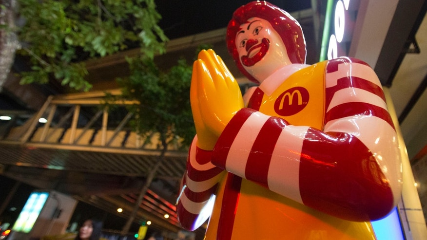 "May 30, 2014 - A McDonald's restaurant in Bangkok, Thailand. The burger chain's famous golden arches have become part of the iconography of anti-coup protests and it is warning activists to ""cease and refrain"" from using its trademark."