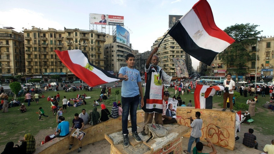 May 30, 2014: Egyptian supporters of Abdel-Fattah el-Sissi, the nations former military chief, wave national flags,  during a celebration in Tahrir Square, in Cairo, Egypt.