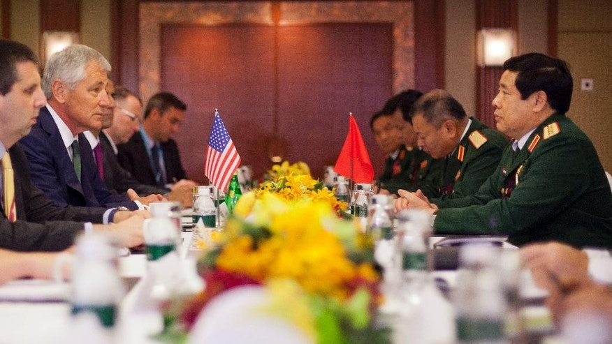 U.S. Defense Secretary Chuck Hagel, second from left, and Vietnam's Defense Minister Phung Quang Thanh, right, during the start of their meeting, Saturday, May 31, 2014 in Singapore. Hagel traveled to Singapore to attend the 13th Asia Security Summit. (AP Photo/Pablo Martinez Monsivais, Pool)