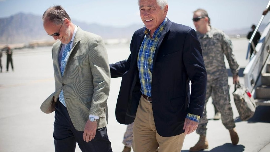 U.S. Defense Secretary Chuck Hagel, right, walks on the tarmac with U.S. Ambassador to Afghanistan James Cunningham, left, during his arrival to Bagram Airfield in Afghanistan, Sunday, June 1, 2014. (AP Photo/Pablo Martinez Monsivais, POOL)