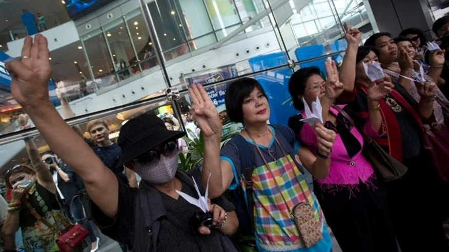 June 1, 2014: Protesters show three fingers represent liberty, brotherhood and equality during an anti-coup demonstration in Bangkok, Thailand. (AP Photo/Sakchai Lalit)