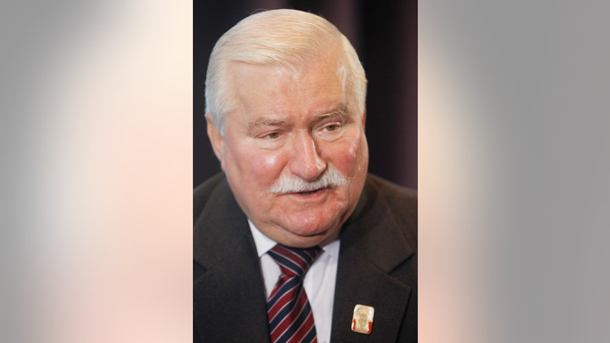 In this May 23, 2014 photo, Poland's former president and Solidarity freedom movement founder, Lech Walesa talks to The Associated Press during an interview in Warsaw, Poland. As Poland prepares to mark the 25th anniversary of communist Poland's first partly free election, which set off a democratic chain reaction across eastern Europe that culminated in the crumbling of the Berlin Wall, Walesa relived triumphs and rued missed opportunities. (AP Photo/Czarek Sokolowski)