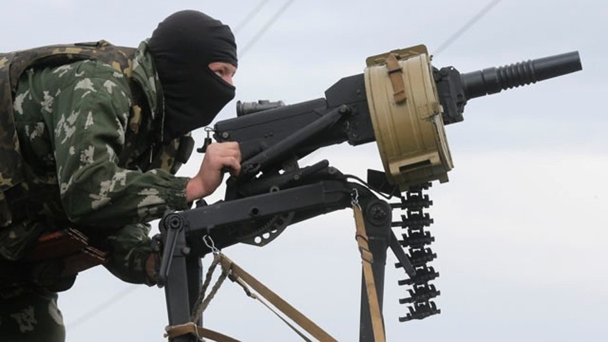 May 31, 2014: A Ukrainian soldier shoots from a grenade launcher, AGS-17 during a battle with pro-Russian separatist fighters at Slovyansk. (AP Photo/Efrem Lukatsky)
