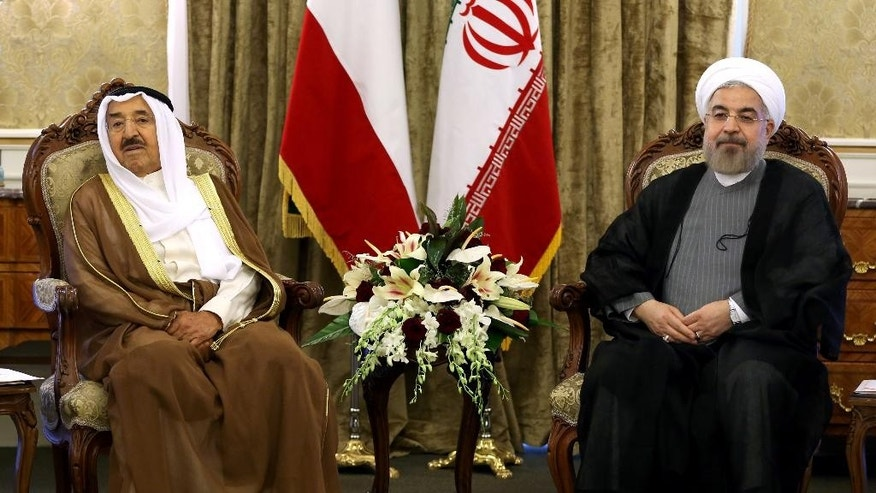 Kuwait's emir Sheik Sabah Al Ahmed Al Sabah, right, and Iranian President Hassan Rouhani, left, meet at the Saadabad Palace in Tehran, Iran, Sunday, June 1, 2014. Kuwait's emir has arrived in Iran's capital, Tehran, for his first visit in decades as the Islamic Republic's relations continue to thaw with Gulf nations under moderate President Hassan Rouhani. (AP Photo/Ebrahim Noroozi)