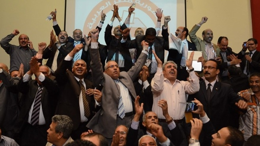 June 3, 2014: Supporters of Egypt's former military chief Abdel-Fattah el-Sissi react to the official announcement declaring him the next president of Egypt with 96.9 percent of the vote, and a turnout of 47.45 percent, at the Election Commission headquarters in Cairo, Egypt.