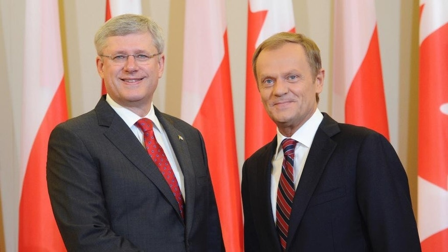 Canada's Prime Minister Stephen Harper, left, and his Polish counterpart Donald Tusk pose for photos before their talks in Warsaw, Poland, Wednesday, June 4, 2014. (AP Photo/Alik Keplicz)