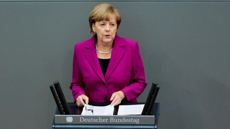 German Chancellor Angela Merkel delivers her so called 'Government Declaration' speech ahead of the G7 summit in front of the German parliament Bundestag in Berlin, Wednesday, June 4, 2014. (AP Photo/Markus Schreiber)