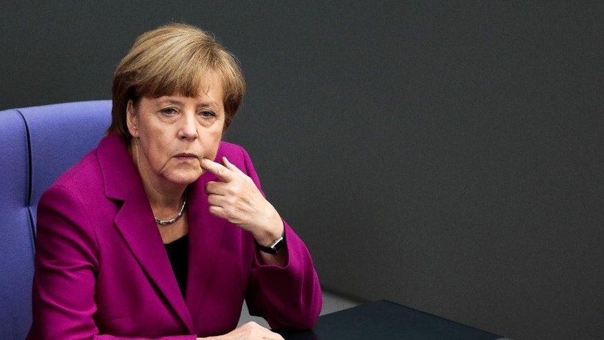 German Chancellor Angela Merkel sits on her chair prior to her so called 'Government Declaration' speech ahead of the G7 summit in front of the German parliament Bundestag in Berlin, Wednesday, June 4, 2014. (AP Photo/Markus Schreiber)