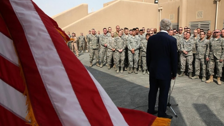 FILE - In this Tuesday, Dec. 10, 2013 file photo, U.S. Secretary of Defense Chuck Hagel, speaks with troops at the Al Udeid air base in Qatar. Qatar's behind-the-scenes role in securing the release of U.S. Army Sgt. Bowe Bergdahl in exchange for five Taliban operatives was a classic move by a tiny but natural gas-rich Gulf state with outsize ambitions that extend to hosting soccer's World Cup in eight years' time. The desert outside the capital Doha is home to al-Udeid Air Base, which serves as a major command and logistics hub for American air power in the region. (AP Photo/Mark Wilson, Pool, File)