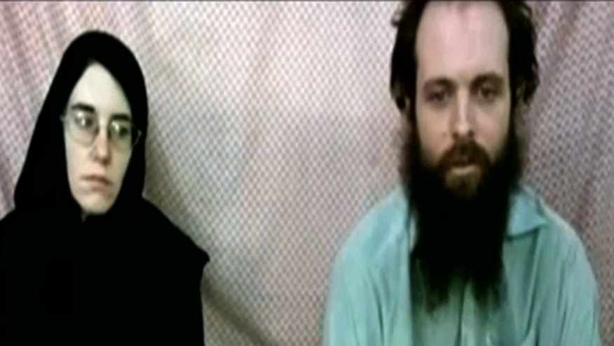 This frame grab from video provided by the Coleman family shows Caitlan Coleman and Joshua Boyle. The family of a then-pregnant American woman who disappeared in Afghanistan in late 2012 with her Canadian husband received two videos last year in which the couple asked the U.S. government to help free them from their Taliban captors, The Associated Press has learned.