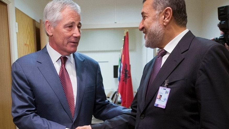 June 4, 2014: U.S. Defense Secretary Chuck Hagel, left, shakes hands with Afghanistan's Defense Minister Bismillah Khan Mohammadi, right, ahead of their North Atlantic Council (NAT) meeting, in Brussels. (AP)
