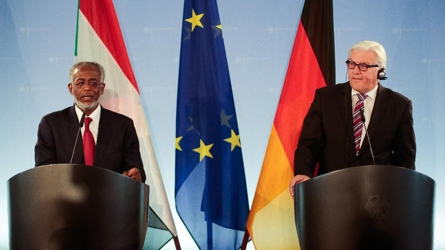 German Foreign Minister Frank-Walter Steinmeier, right, and his counterpart from Sudan Ali Ahmed Karti brief the media after a bilateral meeting at the foreign ministry in Berlin, Wednesday, June 4, 2014. (AP Photo/Markus Schreiber)