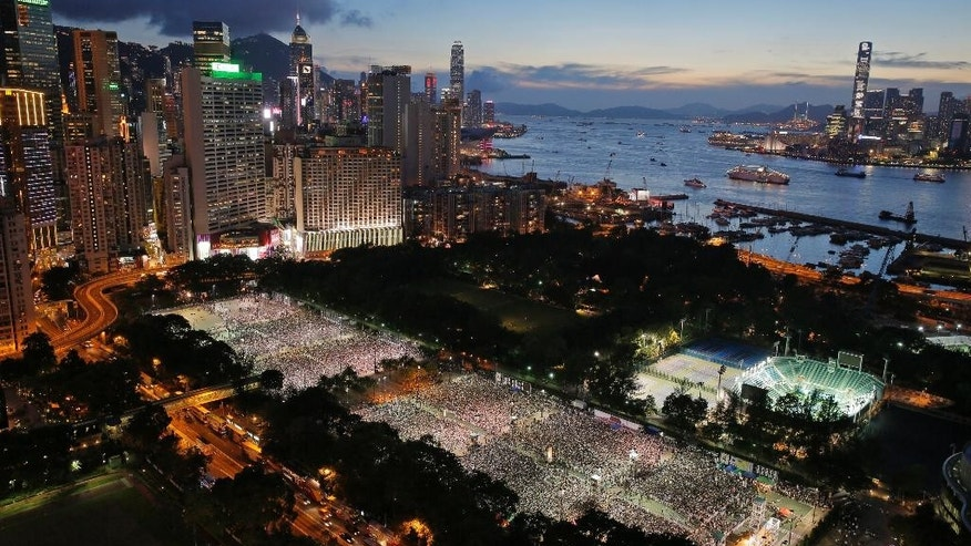 Tens of thousands of people attend a candlelight vigil at Victoria Park in Hong Kong Wednesday, June 4, 2014, to mark the 25th anniversary of the June 4th Chinese military crackdown on the pro-democracy movement in Beijing. (AP Photo/Vincent Yu)